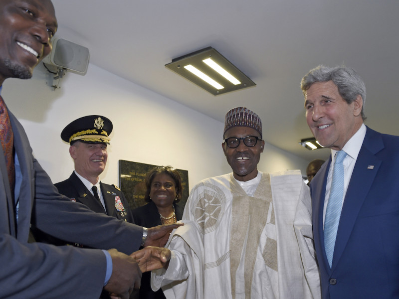 U.S. Secretary of State John Kerry, right, introduces newly inaugurated Nigerian President Muhammadu Buhari, second from right, to Hakeem Olajuwon, left, NBA Legend and Olympic Gold Medalist, before the start of a formal meeting near Eagle Square in Abuja, Nigeria, Friday, May 29, 2015. (AP Photo/Susan Walsh, Pool)